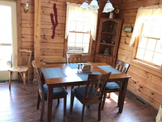 Dining room wooden table in a log cabin