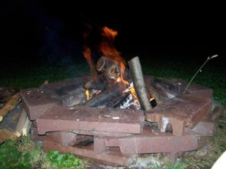 Fire burning in a firepit at night