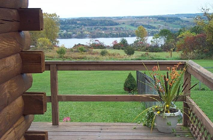 View of Keuka Lake from the deck of a log cabin on a fall day