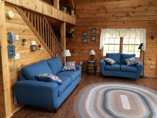 Living Room of A Beautiful Place Log Cabin with blue sofas